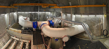 Underground Cavern. Panoramic view of an underground cavern used for drinking water supply. Coincidence of three large bore steel pipes which are equipped with Stock Photo