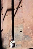 Church. Holy man sitting in front of recessed church in lalibela ethiopia Stock Photography