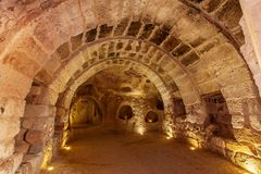 Underground city in Uchisar. The Uchisar underground city is an ancient multi-level cave city in Cappadocia, Turkey royalty free stock image