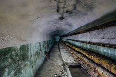 Underground communication tunnel with pipeline.  royalty free stock photo