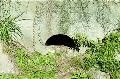 Underground concrete drainage system below the street for excess water in the rain season. Stock Photo