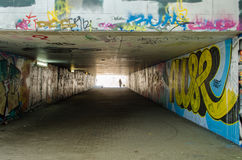 Underground crossing with graffiti smeared walls Royalty Free Stock Photography