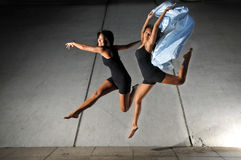Underground Dance 60. Artistic Picture of two Dancers performing athletic contemporary dance moves Royalty Free Stock Photo