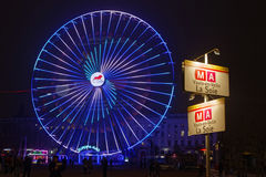 Underground direction and Big Wheel on Place Bellecour Stock Photos