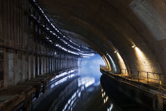 Underground dock. Underground ship dock in the abandoned military base Stock Images