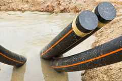 Underground electrical conduits Stock Photo