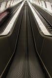 Underground escalator Stock Photos