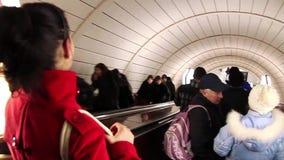 Underground escalator. UKRAINE, KIEV, MARCH 12, 2009: People on escalator to underground station in Kiev, Ukraine, March 12, 2009 stock footage