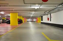 Underground garage. Half empty underground garage or parking Royalty Free Stock Image