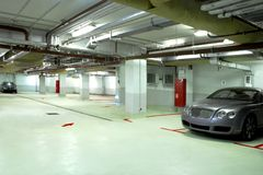 Underground garage. Of the living home with two good cars Royalty Free Stock Images