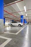 Underground garage. Parking garage, underground interior with a few parked cars Royalty Free Stock Photography
