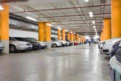 Underground garage. Parking garage, underground interior with a few parked cars Royalty Free Stock Photos
