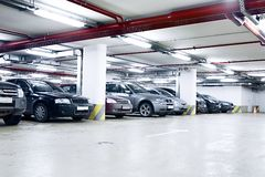 Underground garage. The shined underground garage with the moving cars and parked cars Stock Photography