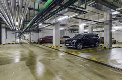 Underground garage with cars Stock Images