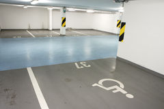 Underground garage for disabled person. Underground garage - parking lot in a basement of house for disabled person Royalty Free Stock Photo