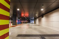 Underground garage or mdern car parking. Control system with barrier or gate, perspective, toned Royalty Free Stock Image