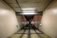 Underground garage or modern car parking. Departure or exit from Underground garage or modern car parking, illuminated concrete tunnel or corridor, perspective Stock Image