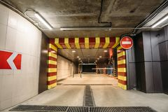 Underground garage or modern car parking. Departure from Underground garage or modern car parking and road sign stop Stock Images