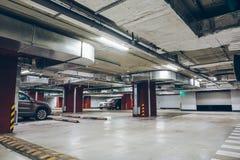 Underground garage or modern car parking. Industrial interior Stock Photography