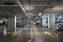 Underground garage or modern car parking with lots of vehicles. Perspective stock images
