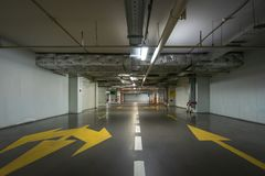 Underground garage or modern car parking with lots of vehicles. Toned royalty free stock images