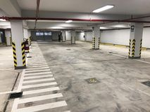Underground garage or modern car parking in shopping center or mall royalty free stock images