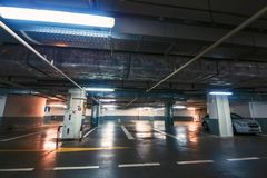 Underground garage or modern car parking. Toned stock images