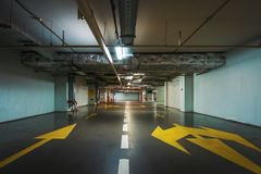 Underground garage or modern car parking. Toned royalty free stock image