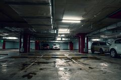 Underground garage parking lot, auto park interior inside. With cars, toned royalty free stock image