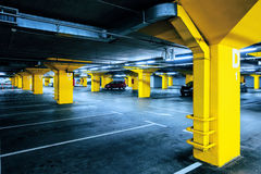 Underground garage parking lot with few cars and empty spaces. For more vehicles, urban exploration and geometry in architecture stock photography