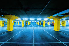 Underground garage parking lot with few cars and empty spaces Royalty Free Stock Image