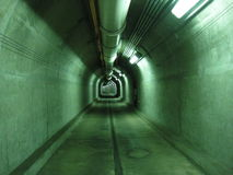 Underground green tunnel. Industrial green interior of underground H2 tunnel in Oahu Stock Photography