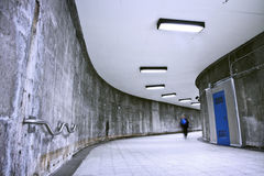 Underground Grunge metro corridor - one person Royalty Free Stock Photo