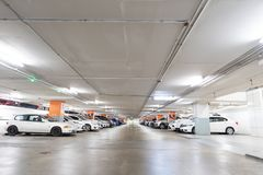 Underground interior garage parking lot with many cars. Underground interior garage parking lot with many cars royalty free stock image