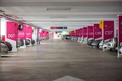 Underground interior garage parking lot with many cars. With ladies parking sign board royalty free stock photos