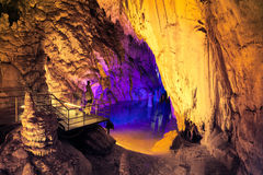 Underground lake in Dim cave. People admire the beauty of underground lake in Dim cave. Valley of Dim river, Alanya, Turkey Royalty Free Stock Images