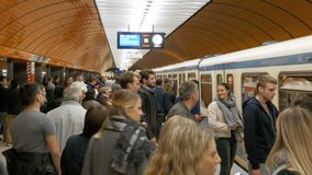 Underground metro in Munich. People getting out and into the train stock video footage