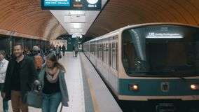 Underground metro in Munich. The train departs from the station. MUNICH, GERMANY, SEPTEMBER 15, 2017: Underground metro in Munich. The train departs from the stock footage