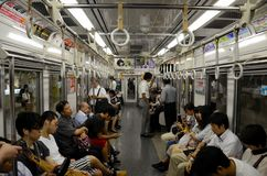 Underground metro subway train carriage with people in Tokyo Japan Royalty Free Stock Images