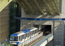 Underground Metro train underneath road bridge Stock Image