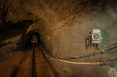 Underground  Mine Tunnel. An underground Iron ore mine tunnel with rails and a safety phone. Photographed in Germany Royalty Free Stock Photos