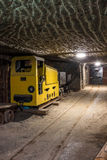 Underground mine tunnel with mining equipment Stock Images