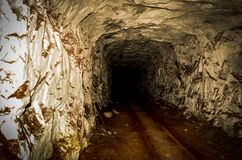 Underground mining tunnel with rails. Tunnel, rocks and rails underground in mine Royalty Free Stock Image