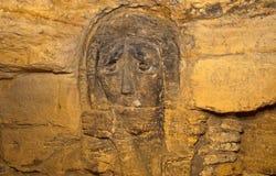 Underground monumet. Stone face of prayer underground, old USSR monument Stock Image