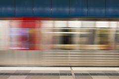 Underground in motion. Blurred motion of the train in underground station of subway royalty free stock photography