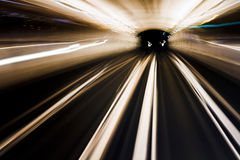 Trails of underground train in movement Stock Photography
