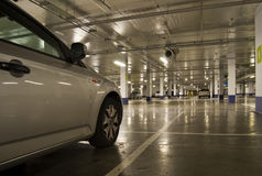 Underground parking. With car in front Royalty Free Stock Photo