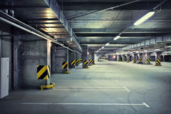 Underground parking. Empty underground parking garage at night Stock Images
