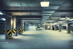 Underground parking. Empty underground parking garage at night Royalty Free Stock Images