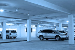 Underground parking, blue toning Stock Photos